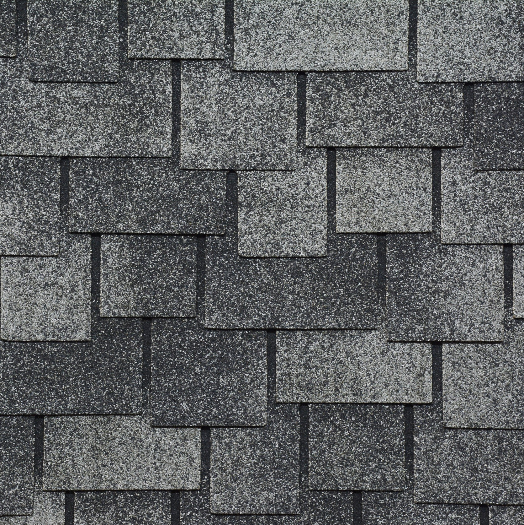 A close up picture of asphalt roofing shingles.