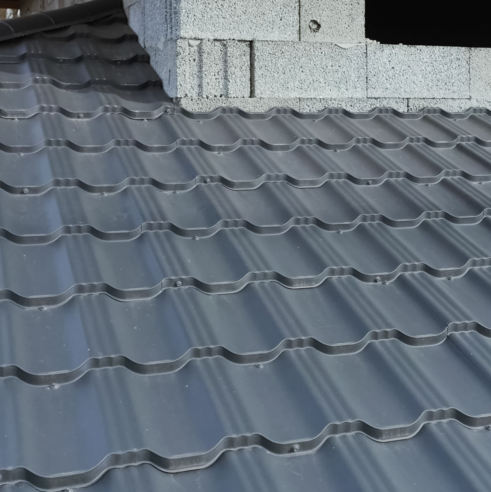 A metal tile roof with a distinctive pattern.