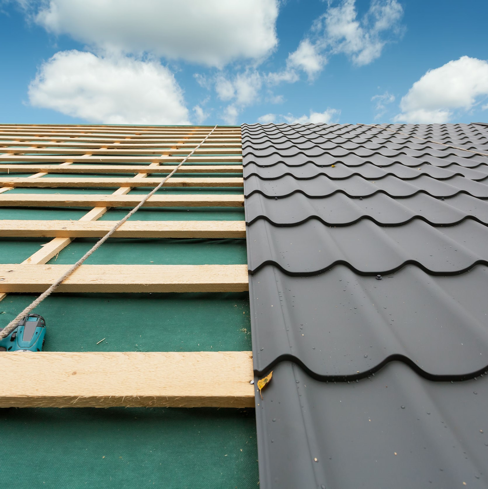 Stone coated steel roofing being placed on a roof.